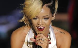 """FILE - In this Wednesday, July 10, 2013 file photo, singer-songwriter Rihanna performs at Le Sporting in Monaco during her """"Diamonds World Tour"""" to Europe. Rihanna has left behind a trail of racy tweets and an incriminating Instagram photograph from a Thailand trip that led police to arrest two men..."""