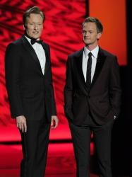 Conan O'Brien, left, and Neil Patrick Harris speak onstage at the 65th Primetime Emmy Awards at Nokia Theatre on Sunday Sept. 22, 2013, in Los Angeles.