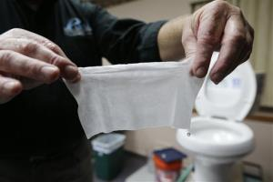Rob Villee, executive director of the Plainfield Area Regional Sewer Authority in New Jersey, holds up a wipe he flushed through his test toilet in his office.
