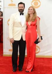 Jon Hamm, left, and Jennifer Westfeldt arrive at the 65th Primetime Emmy Awards at Nokia Theatre on Sunday Sept. 22, 2013, in Los Angeles.