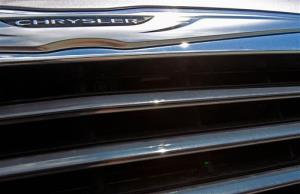 FILE - In this Monday, July 29, 2013, file photo, a Chrysler 300 sits on the lot of Midstate Motors in Berlin, Vt. Chrysler Group said Monday, Sept. 23, 2013, it is preparing an initial public offering of some of its shares. Chrysler filed paperwork for the IPO with the...