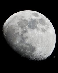 The International Space Station can be seen as a small object in lower right of this image of the moon.