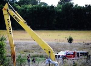 Crews work to excavate a vehicle from an embankment near Beresford, South Dakota, yesterday.