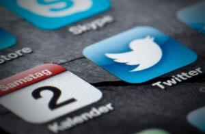"""FILE - This Feb. 2, 2013, file photo shows the display of a smartphone in Berlin. Twitter shows the company's posting on its official account Thursday, Sept. 12, 2013, that it has """"confidentially submitted an S-1 to the SEC for a planned IPO."""" Twitter is taking advantage of federal legislation..."""