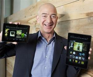 Jeff Bezos holds up the all-new Kindle Fire HDX 8.9'', right, and Kindle Fire HDX 7'' tablet in this promotional image