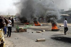 Protesters burn tires and close the highway to northern cities amid a wave of unrest over the lifting of fuel subsidies by the Sudanese government.