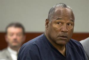 In this May 16, 2013 file photo, OJ Simpson listens during a hearing in Clark County District Court, Thursday, May 16, 2013 in Las Vegas.