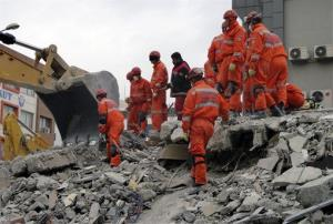 File photo of rescue workers searching for survivors in the rubble of a collapsed hotel in Van, Turkey.