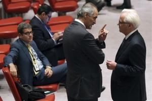 Syrian Ambassador to the United Nation Bashar Ja'afari, center, speaks to Russian Ambassador Vitaly Churkin before a Security Council meeting Friday.
