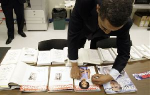 Barack Obama autographs magazines and books in Johnstown, Pa. Tax returns show he earned nearly $4M in royalties from his books last year.