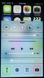 An iPhone with iOS 7 software displays the new look of the Control Center.