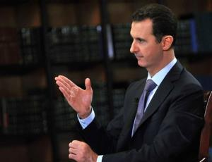 President Bashar Assad gestures as he speaks during an interview with Italy's RAI News 24 TV, at the presidential palace in Damascus, Syria, Sunday, Sept. 29, 2013.