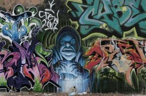 The side of  the Los Angeles River is decorated with a mural depicting a sorcerer in a hoodie sweatshirt conjuring a spray can is seen on Wednesday, Jan. 16, 2008.