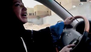 A Saudi Arabian woman, apparently unconcerned about her ovaries, drives a car as part of a campaign to defy the kingdom's ban on women driving