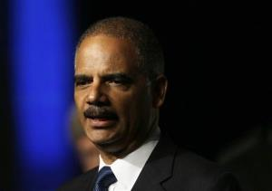 In this Aug. 12, 2013, file photo Attorney General Eric Holder speaks to the American Bar Association Annual Meeting in San Francisco.