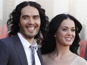 In this April 19, 2011 file photo, British actor Russell Brand and his wife Katy Perry arrive for the European premiere of Arthur, in London.