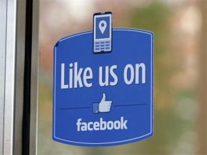 A sign with Facebook's Like logo is posted at Facebook headquarters near the office for the company's User Operations Safety Team in Menlo Park, Calif.