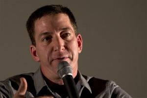 Journalist Glenn Greenwald talks during a panel following the screening of the Dirty Wars documentary at the Rio Film Festival in Rio de Janeiro, Brazil.