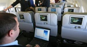 A person demonstrates the capabilities of a laptop during a media preview flight aboard an Airbus A320 aircraft equipped with an onboard WiFi.