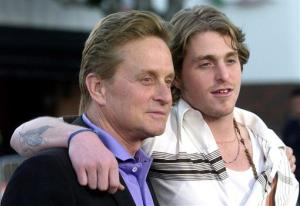 Michael Douglas, left, and his son, Cameron Douglas  pose at a film screening in the Westwood section of Los Angeles, on April 7, 2003.