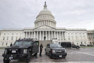 U.S. Capitol Police personnel keep watch on the East Plaza of the Capitol in this Monday, Sept. 16, 2013, file photo.