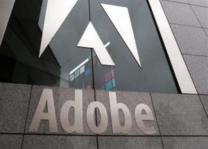 In this file photo, an exterior view of the Adobe headquarters is seen in San Jose, Calif.