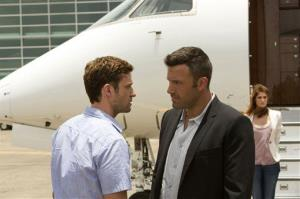 This image released by 20th Century Fox shows Justin Timberlake, left, and Ben Affleck in a scene from Runner Runner.