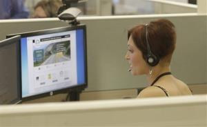 Gina Macaluso, an employee of  Covered California, the state's new health care exchange, provides health insurance at the  newly opened call center in Rancho Cordova, Calif., Tuesday, Oct. 1, 2013.