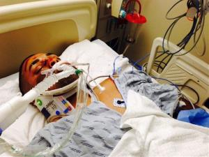 This undated photo provided by his family's attorney on Friday shows Edwin Mieses Jr., the injured biker.