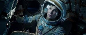 "Sandra Bullock in a scene from Gravity. Bullock says making the lost-in-space movie directed by Alfonso Cuaron was her ""best life decision"" ever."