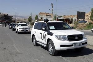 A convoy of inspectors from the Organization for the Prohibition of Chemical Weapons prepares to cross into Syria at the Lebanese border.