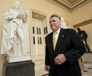 In this Spet. 30, 2013, photo, Rep. Peter King, R-N.Y., walks towards the House Chamber on Capitol Hil.