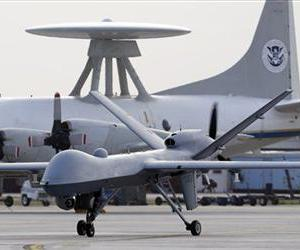 In this Nov. 8, 2011 file photo, a Predator B unmanned aircraft taxis at the Naval Air Station in Corpus Christi, Texas.