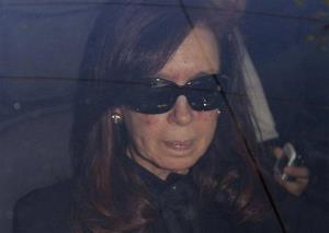 Argentina's President Cristina Fernandez arrives to a local hospital, in Buenos Aires, Argentina, Monday, Oct. 7, 2013.
