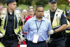 Rep. Keith Ellison D-Minn., is arrested by US Capitol Police officers on Capitol Hill during a immigration rally in Washington.