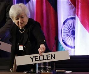 Janet Yellen, vice chair of the Board of Governors of the Federal Reserve, places her name plate at her seat at the International Monetary Conference in Shanghai, China, in this June file photo.