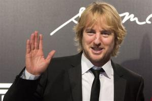 Owen Wilson poses for photos at the 2013 Pirelli Calendar red carpet event in Rio de Janeiro, Brazil, Tuesday, Nov. 27, 2012.