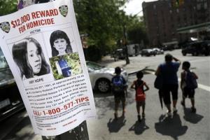 A Tuesday, July 23, 2013, file photo shows a poster soliciting information regarding an unidentified body near the site where the body was found in New York.