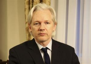In this July 30, 2013 file photo, WikiLeaks founder Julian Assange sits inside the Ecuadorian Embassy in London.