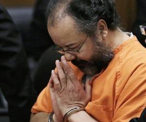 In this Aug. 1, 2013 file photo, Ariel Castro bows his head in the courtroom during his sentencing sentencing in Cleveland.
