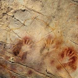 This file photo shows stenciled hands the El Castillo Cave of Spain.