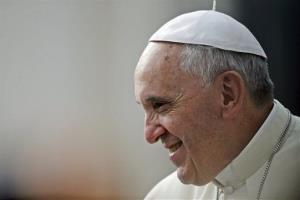 Pope Francis smiles during the weekly general audience in St. Peter's Square, at the Vatican, Wednesday, Oct. 9, 2013.