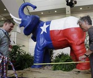 Workers put the final touches on the stand for a Texas flag colored elephant statue during the set up before the start of the Texas Republican Convention in this  June 6, 2012 file photo.