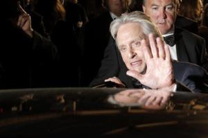 Actor Michael Douglas enters a car following the screening of Behind the Candelabra at the 66th international film festival, in Cannes, southern France, Tuesday, May 21, 2013.