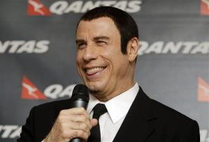 American actor John Travolta, laughs during a news conference in Dubai, United Arab Emirates Monday, Sept. 9, 2013.