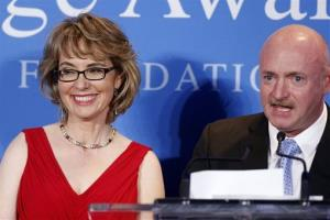 Capt. Mark Kelly speaks next to his wife, former Arizona congresswoman Gabrielle Giffords.