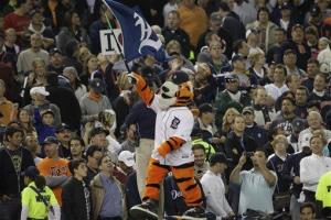 Paws, the Detroit Tigers mascot, rallies the crowd.