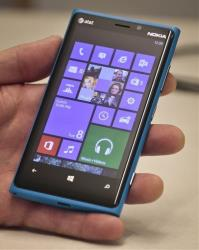 Greg Sullivan, director for Microsoft Windows phone, shows a Nokia phone with new software during an interview on Tuesday, Oct. 8, 2013.