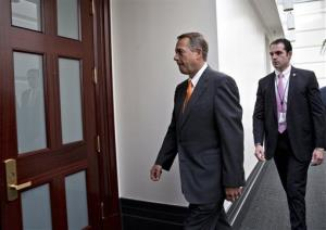 Speaker of the House John Boehner arrives for a meeting with House Republicans Wednesday.