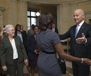 Joe Biden greets Environmental Protection Agency workers as they return to work after 16 days of a government shutdown at the William Jefferson Clinton Federal Building, Oct. 17, 2013.